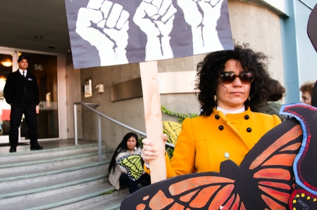 Migrant justice organizer Alejandra Lopez Bravo outside the offices of Force Four Entertainment. Photo by David P. Ball