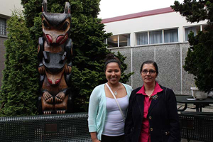 Emerging Aboriginal Scholars alumna Shaniece Angus stands with Melania Alvarez, from the Pacific Institute for the Mathematical Sciences, outside Britannia Secondary School. Photo by Katie Hyslop - the Tyee