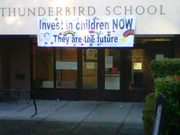 Invest in children Now. Banner at Thunderbird Elementary School - Vancouver. Photo - Jane Bouey