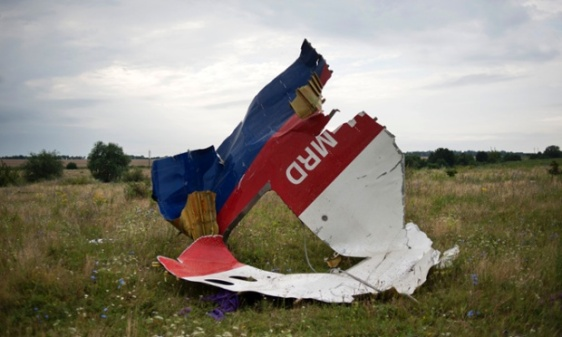 A piece of the fuselage of flight MH17. Photograph: Evgeniy Maloletka/AP