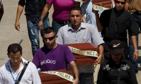 Relatives carry children's coffins at a mass funeral in Barranquilla on 11 September 2010 after authorities turned over the corpses of six victims of the army's 'false positives' scandal. Photograph: Reuters