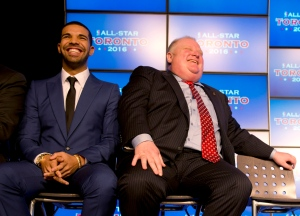 Rapper Drake (left) and Toronto Mayor Rob Ford share a laugh at a 2014 news conference. CANADIAN PRESS/Frank Gunn
