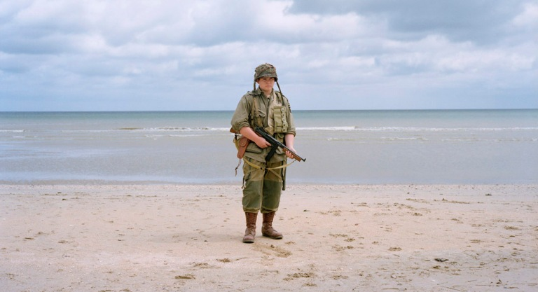 Frankrijk, La Madeleine, 03-06-2012 A re-enactor dressed up as an American World War II soldier, poses near the Utah Beach Landing Museum, which is set up at the site of the U.S. landing on 6 June 1944 in Normandy. The 'Musee du Debarquement d'Utah Beach' (Utah Beach Landing Museum) is set up at the site of the U.S. landing on the 6th of june 1944 at Utah Beach. Reenactors pose on the beah PHOTO AND COPYRIGHT ROGER CREMERS